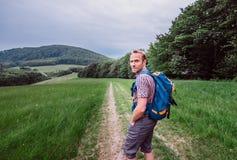 Man walks on mountain hills Stock Image