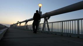 Man walks over the Gold Coast Pier stock video