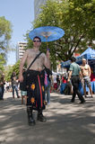 Man walks with a parasol at the Toronto Gay. Topless man walks with a japanese parasol at the Toronto Gay Pride procession Royalty Free Stock Photo
