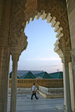 A man walks past an arch of the Mausoleum of Mohammed V on the Y Royalty Free Stock Photo
