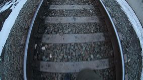Man walks by rail journey  legs in  boots  video stock footage