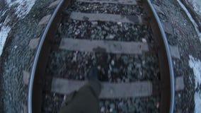 Man walks by rail journey  legs in  boots  video stock video