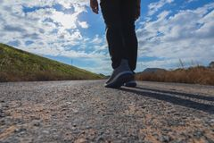 The man walks on the road. stock image