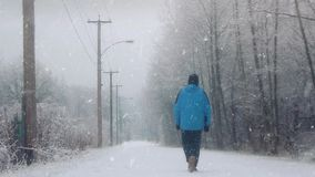 Man Walks On Road In The Snow stock video footage