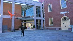 Man walks toward New Bedford Whaling Museum stock photos