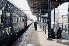 Man Walks Beside Train Stock Photo