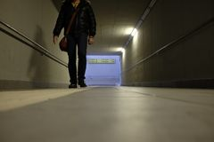 Man walks in the underpass. Station Stock Photos