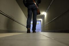 Man walks in the underpass. Station Stock Image