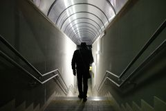 Man walks in the underpass. Station Royalty Free Stock Photo