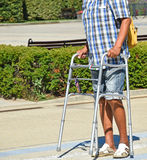Man walks with a walker Stock Photos