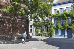 Man walks with water bottles in old part Patershol of ghent in b Royalty Free Stock Photos