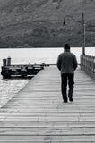 Man walks on a wharf Stock Image