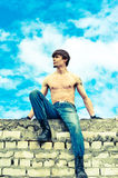 Man on the wall. A man sitting on the wall and looks into the distance Stock Photography