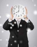 Man with wall clock Stock Photo