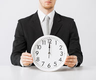 Man with wall clock Stock Image