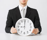 Man with wall clock Stock Images