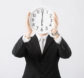 Man with wall clock Royalty Free Stock Images