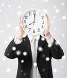 Man with wall clock Royalty Free Stock Image