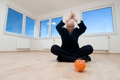 Man wants to break piggy bank. Man holding hammer over orange piggy bank Royalty Free Stock Images