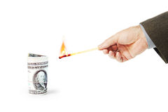 Man wants to set fire a roll of dollar banknotes Stock Images