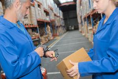 Man in warehouse wearing hand held scanner Royalty Free Stock Photo