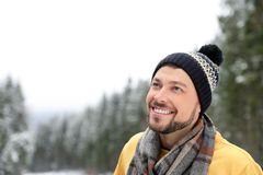 Man in warm clothes outdoors, space for text. Winter vacation stock photos