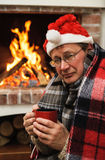 Man in warm clothing with cup Royalty Free Stock Image