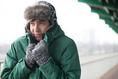 Man in warm clothing shivering outdoors Royalty Free Stock Images