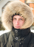 Man in warm jacket with furry hood royalty free stock photo