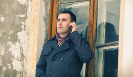 The man in warm jacket with mobile phone Stock Photos