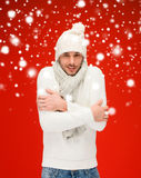 Man in warm sweater, hat and scarf Stock Image
