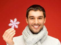 Man in warm sweater and scarf with snowflake Stock Images