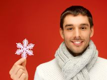 Man in warm sweater and scarf with snowflake Royalty Free Stock Photography