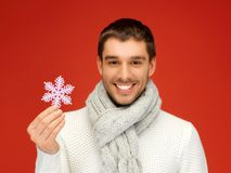 Man in warm sweater and scarf with snowflake Stock Photo