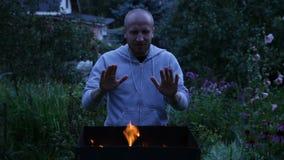 Man warming hands near the fire stock video