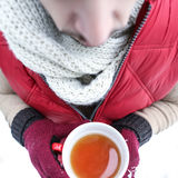 Man warming on a hot cup of tea Royalty Free Stock Image