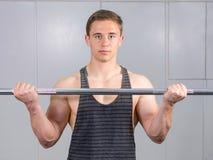 Man warming up his biceps Royalty Free Stock Photo