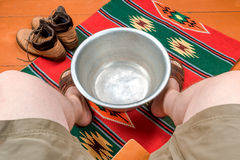 Man warms his feet in a basin of water Royalty Free Stock Image
