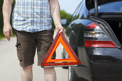 Man with warning triangle Royalty Free Stock Photo