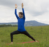 Man in Warrior Pose during yoga outdoors in nature stock photos