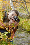Man was inclined over a stream Royalty Free Stock Photography