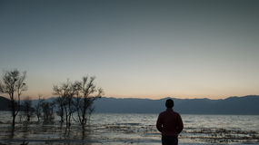 Man was looking by the erhai lake royalty free stock photography