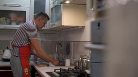 The man was washing the dishes. Close up of hands and crane. stock footage