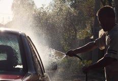 Man washes car hose big head spray royalty free stock image