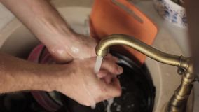 Man washes a dishes, close-up of hands and sponge stock footage