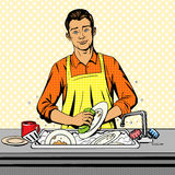 Man washes dishes pop art style vector Stock Photography