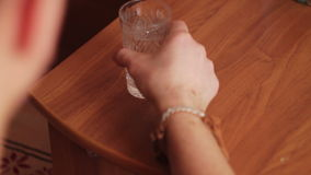 Man washes down the pill with a glass of water stock footage