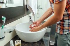 Man washes hands in the beautiful bathroom Royalty Free Stock Photos