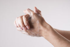 A man washes his hands with soap and water Royalty Free Stock Photography