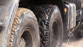 Man washes truck wheel stock video